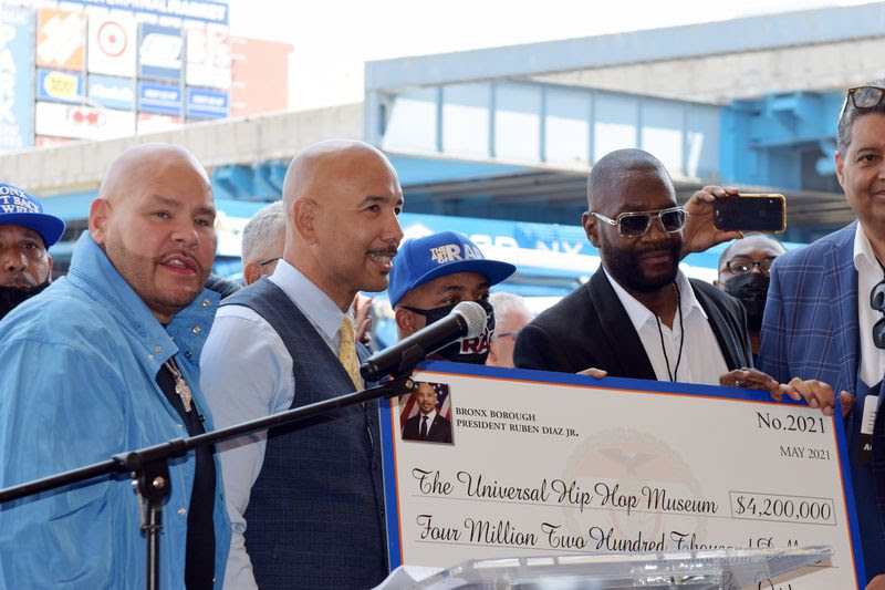 A $4.2 million dollar check is presented at the groundbreaking ceremony for the Universal Hip Hop Museum and the first phase of Bronx Point on May 20, in the Bronx.
